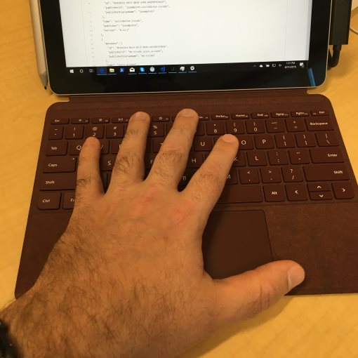My hand on the Surface Go keyboard